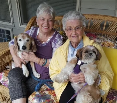Residents holding their pets at their Independent Living Homes in Federal Way