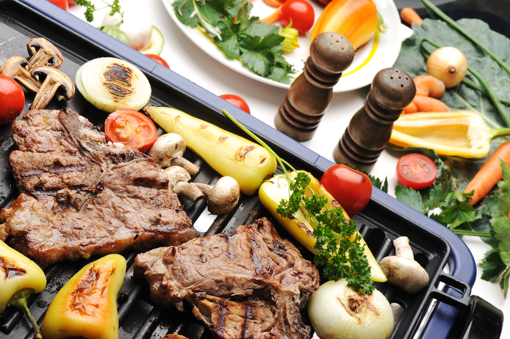 Barbecue, prepared beef meat and different vegetables and mushrooms on grill-1