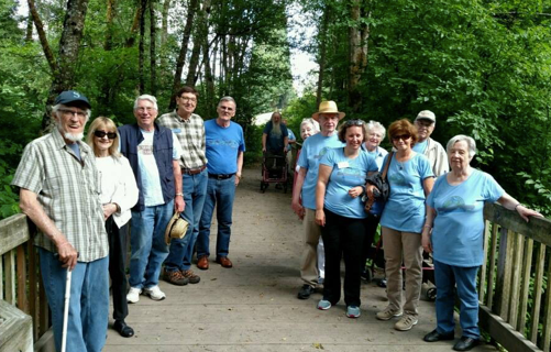 Walking Group who Live in Senior Apartments at Village Green Retirement Campus